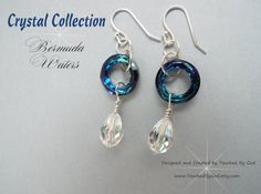 These stunning earrings are handmade with Swavorski Bermuda Blue Cosmic Circles & Crystal AB Teardrop pendants. The circle is a symbol of life, hope, and karma. These crystals are modern and stylish as well as timeless and classic. All around beautiful, everyday staple earrings that makes an excellent gift idea for any of the wonderful women in your life! These earrings are also statement pieces for Brides, Bridesmaids & Mothers of the Bride or Groom! Visit my shop at…
