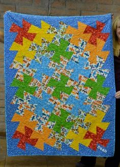 Baby / little boy quilt made with Robert Kaufman prints and primary colors.  Modern pinwheel using the Twister Ruler.  Planes, Trains, Automobiles & Monkeys too.  By Dawn