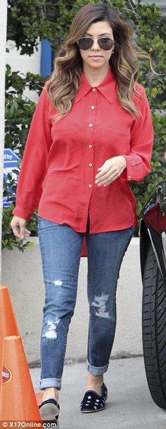 Kourtney Kardashian: In A Red, Button Up Shirt; Ripped, Rolled-Up Jeans; Starred Penny Loafers.