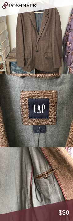 Gap men's coat Gorgeous brown with mixed colors coat from Gap men. Outer shell is 75% wool, inside in 100% cotton. Has 2 outside pockets and two inside pockets (one pictured). Excellent condition. No stains, rips. Smoke free home GAP Jackets & Coats