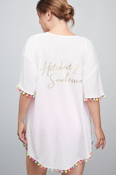 """This semi-sheer """"Hitched & Sunkissed"""" kimono bathing suit cover up is the essential piece to pack for a destination wedding or a beach honeymoon. A festive trim of pom poms completes this beach-bound look. Wrap Bathing Suit, Bathing Suit Covers, Bathing Suits, Bridal Swimwear, Diy Wedding, Wedding Ideas, Davids Bridal, Up Styles, Marie"""