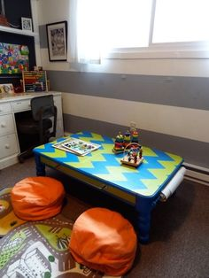 Kid's art table - fun & playful room.  Featured @Apartment Therapy
