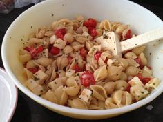 Pasta salad  Combine olive oil, lemon juice, onion, garlic cloves crushed and chopped mozerrella cheese, add 4 fresh basil leaves cut into pieces and oregano   Toss slice grape tomatoes and let sit while pasta cooks. When pasta is cooked drain, let cool add to bowl. Enjoy