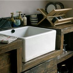 ceramic kitchen sink. i couldl do with a long shallow one though, just like the one in julie and julia!!  i hate the very popular SS sinks and the drain boards.
