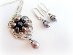 Peacock pearl earrings and pendant necklace jewelry set, purple freshwater pearl drop earrings, freshwater pearl pendant necklace by MalinaCapricciosa on Etsy https://www.etsy.com/listing/234768818/peacock-pearl-earrings-and-pendant