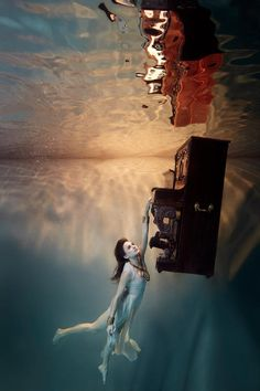 """The Flood"" is an impressive photo series by Belgium-based photographer Harry Fayt that features Belgian soul singer Typhene Barrow immersed in an underwater world Under The Water, Under The Sea, Underwater Pictures, Underwater Art, Underwater Photography, Underwater Photoshoot, Underwater Model, Breathing Underwater, Levitation Photography"