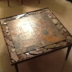 I picked up a table from a rummage sale, bought cheap tiles and then arranged and broke tiles to make the border.....super cheap and unique coffee table!