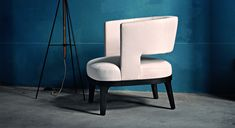 The spacious Astrid armchair with base and legs in solid wood and an upholstered…