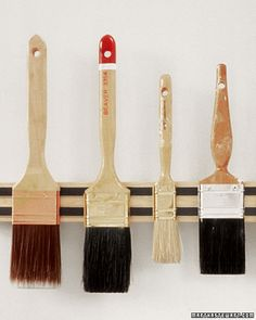 Organize The Garage - Paintbrush Rack - using a magnetic kitchen knife holder to hold brushes keeps bristles from getting bent. Brilliant!