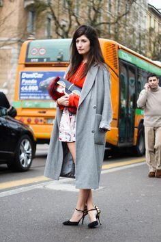 Milan  Play on proportions: teeny shorts, long coat, big hair.