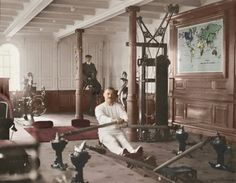 A photo of the ship's gymnasium, which include a punching bag, a rowing machine, and exercise bikes.