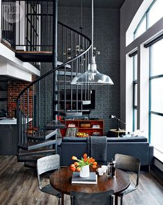 Modern loft with black walls. For more, visit houseandleisure.co.za