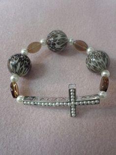 Leopard print, pearl, and amber horizontal cross bracelet