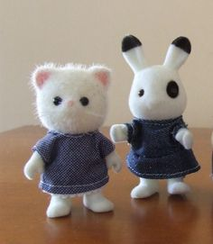 Sylvanian Families - clothes made from patterns at http://www.246.ne.jp/~jr1vvc/sylvanian.html - In Japanese, but click through the links for diagrams and templates