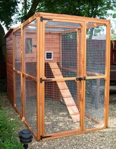 "An enclosed cat run, or ""catio"" is a great way to give your cat her outdoor fix while keeping her safe!"