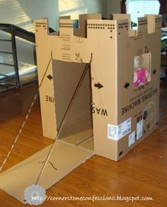 Cardboard castle - 27 DIY Kids Games and Activities Can Make With Cardboard Boxes