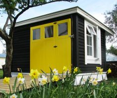 It's the colour of bumble bees so why not a classic shed. Built by the owners of Hunter Architecture and Red Shed, the door is painted in Resene Turbo and the w. Exterior Color Schemes, Exterior Paint, Exterior Design, Shed Colours, House Colors, Paint Colours, Recycled House, Recycled Wood, Yellow Doors