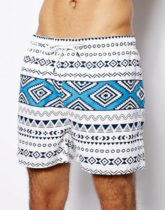 $33, White and Blue Print Shorts: Another Influence Geo Tribal Swim Shorts. Sold by Asos. Click for more info: https://lookastic.com/men/shop_items/60093/redirect