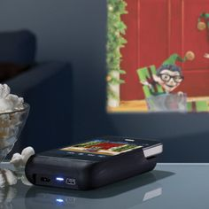 Iphone projector $229 at Brookstone. Cool, just add Keynote and you can run an entire presentation from your iPhone!