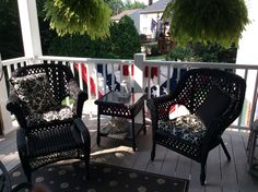 Covered porch with black wicker furniture and patriotic bunting