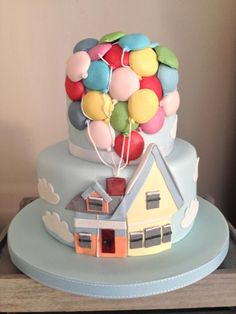 'Disney 'Up Cake' Two tier, chocolate mud and vanilla bean cake. Lots of fondant balloons lifting Disney 'Up cake' ~ all edible