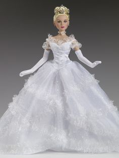 Cinderella Pale blonde rooted saran hair White satin and glitter tulle gown with an attached petticoat White gloves Beaded necklace Nude pantyhose ... #TonnerDolls #FashionDolls