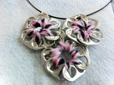 Upcycled Aluminum Soda Pop Can Tab Necklace Pink and Black Stars. $12.50, via Etsy.