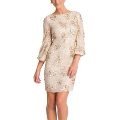 Badgley Mischka Sequin Bell Sleeve Sheath dress Badgley Mischka Sequin Bell Sleeve Sheath oozes evening elegance. Your night will shine in this stunning style. Nude silk georgette with copper paillette embroidery. Crew neckline. 3/4 length bell sleeves with elastic hem. Hidden back zip. Worn only once Badgley Mischka Dresses
