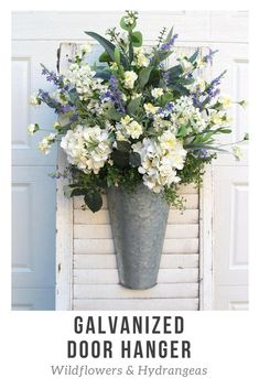 Farmhouse Decor~Spring Wreath for Front Door~Farmhouse Wall Hanger~Lavender, Wildflowers and Hydrangeas in a Galvanized Door/Wall Hanger--This is a beautiful and full door hanger that is sure to bring vibrancy and charm to your front door. #affiliate #farmhouse #farmhousestyle #farmhousedecor #homedecor