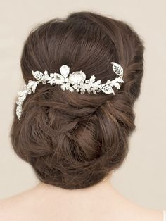 Silver and clear rhinestone bridal hair comb made up of beautiful rhinestone leaves coming off of three large center stones by Hair Comes the Bride.