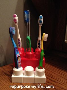 MEGA BLOCK TOOTH BRUSH HOLDER. GENUIS! Stack 'em. Hot glue them together. Drill holes for the number of toothbrushes you have!