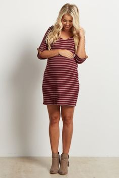 You can never go wrong with this chic striped maternity dress. A classic striped print that never goes out of style, and 3/4 sleeves perfect to wear for any kind of weather. Style this dress with a gorgeous statement necklace and heels for a perfect day to night ensemble.