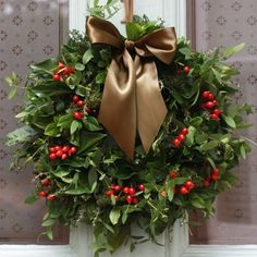 Beautiful Natural Christmas Wreath Composed Of Green Leaves And Red Berries With A Large Brown Ribbon . Outdoor Christmas Wreaths, Christmas Wreaths To Make, Christmas Flowers, Natural Christmas, Noel Christmas, Holiday Wreaths, Beautiful Christmas, Christmas Crafts, Cheap Christmas