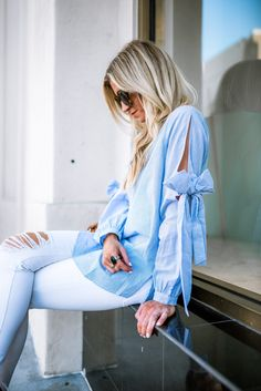 Blue bow sleeved blouse + cognac booties.