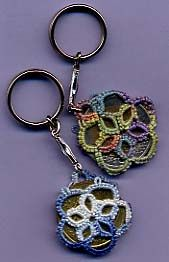 Tatting around a coin.  What a neat way to make a key chain and add a little weight to the tatting.