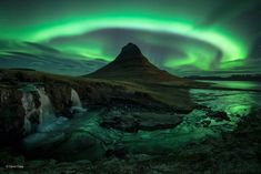 Magic mountain Finalist 2014 | Earth's Environments David Clapp, United Kingdom  David had travelled to Iceland partly to photograph the auroras, choosing to visit the Snaefellsnes peninsula because of its spectacular scenery. He had first set up by the frozen river below Mount Kirkjufell, but when the show intensified he scrambled up the bank to a pre-planned viewpoint with the mountain as the focus.