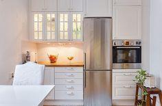 skinny fridge + lighted cabinets