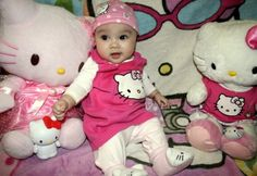 Baby with hello kitty stuffies