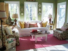 """Cottage Living Room - """"While more modern interpretations of shabby chic couture focus on soft, faded hues and muted tones, more traditional cottage-inspired designs, like this cozy sunroom, use palettes of warm yellow, sage green and salmon pink. While still integrating feminine floral patterns into the mix, stripes, plaid and gingham bring in an eclectic feel with country flair"""" - Kayla Kitts"""