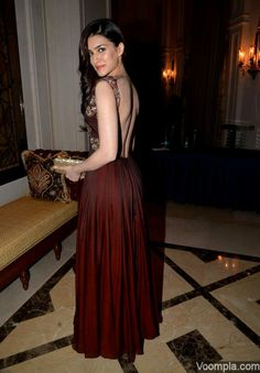 Kriti Sanon in a backless burgundy Manish Malhotra gown at the Amazon India Couture Week. via Voompla.com