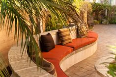Tropical Patio with Bed Bath and Beyond Solid Outdoor Settee Cushion in Orange, exterior stone floors, Pathway, Fence