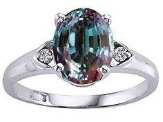 alexandrite ring- the stone changes color depending on the light source, from a blueish green in natural light to a more purple/red tone in artificial light