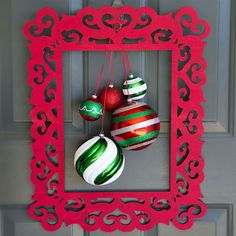 It's easy to make this different twist on a traditional holiday wreath, simply hang ornaments from a painted laser cut frame.