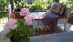 throw & cushions & geranium  from Valkoinen Puutalokoti
