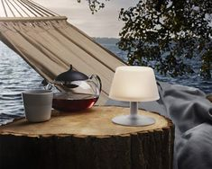 This stunning solar cell Sunlight Table Lamp from the Danish brand Eva Solo makes for a unique addition to the home, whether it's inside or out. It has no cable so it isn't restricted to being next to a plug socket and is very tidy. Just put the lamp i Design Shop, Design Online Shop, Glass Teapot, Heat Resistant Glass, Tea Eggs, Solar Lamp, Garden Table, Led Lampe, Frosted Glass