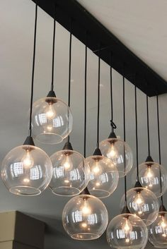 Bhs illuminate atelier carmella 10 light cluster glass and this would be cool over my kitchen island workwithnaturefo