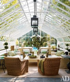 The greenhouse turned pool cabana contains Wicker Works chairs gathered around a Corrigan-designed cocktail table; the rope-base lamp is from Mecox, and the sisal is by Patterson, Flynn & Martin - From Architectural Digest June 2013 Architectural Digest, Outdoor Rooms, Indoor Outdoor, Outdoor Living, Indoor Garden, Exterior Design, Interior And Exterior, Modern Interior, Gazebos