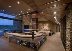 Family room- don't like colors, but love high ceiling, glass wall and lots of couch space