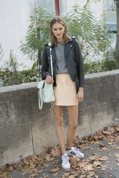A white pair of sneakers went well with another 2014 staple: the leather jacket.