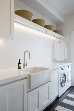 A fresh, Hamptons style laundry with ample hanging space. Notice the clever stri… A fresh, Hamptons style laundry with ample hanging space. Notice the clever strip lighting above. Home, Laundry Room Lighting, Room Renovation, House, Farmhouse Laundry Room, Laundry In Bathroom, Modern Laundry Rooms, Room Design, Hanging Rail